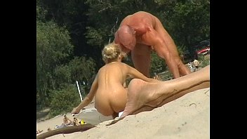 Very Busty, beautiful topless teen at the beach, candid bouncing boobs