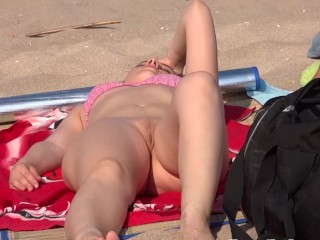 Sexy Beach Babe Almost Embarrassed by a Nipslip - Ironic as Her Shaved Pussy is on Full Public View!